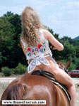 Blond girl on horseback