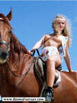 Pretty blond girl riding on horseback